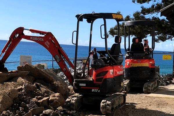 Mini Excavator from Diggermate retaining walls